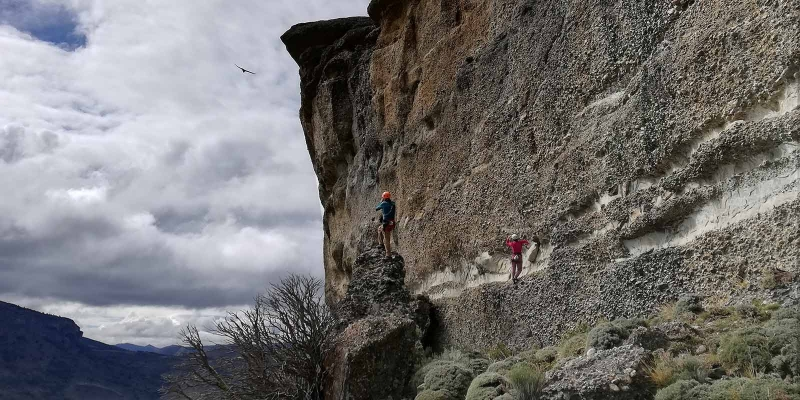 rock climbers and condor flying by